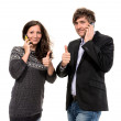 Man and woman with cell phones — Stock Photo