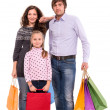 Stock Photo: Family with shopping bags