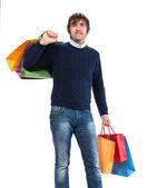 Homem bonito com sacos de compras — Fotografia Stock