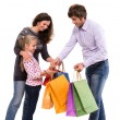 Family with shopping bags — Stock Photo #33219881
