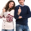 Smiling man and woman showing thumbs up sign — Stock Photo