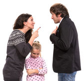 Sad looking girl with her fighting parents — Stock Photo