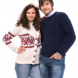 Smiling family couple in sweaters — Stock Photo #33535133