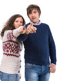 Man and woman pointing at camera — Stock Photo