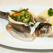 Steamed  trout with vegetables on white dish — 图库照片