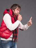 Man blowing a whistle and pointing — Stock Photo