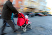 Father walks with the child in the stroller — Stock Photo