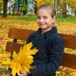 Autumn portrait of smiling little girl — Stock Photo