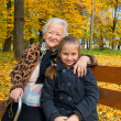 Grandmother and child sitting on the bench — Stok fotoğraf