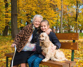 Grandmother and child sitting on the bench — Stock Photo