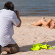 Photographer and nude model — Stock Photo