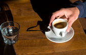 Man's hand a with cup of coffee — Stock Photo
