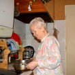 Old woman preparing food — Stock Photo