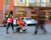 Mother walks with the child in the stroller — Stock Photo