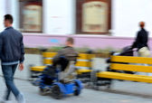 Invalid man on the wheelchair — Stock Photo