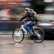 Man on bicycle in the city — Stock Photo #34955473