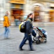 Parents walks with the child in the stroller — Stock Photo