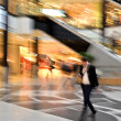 Man in motion at the modern shopping mall — Foto Stock