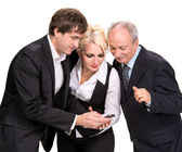 Group of business people looking at a cell phone — Stock Photo