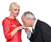 Man kissing woman's hand — Stock Photo