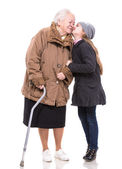 Granddaughter kissing her grandmother — Stock Photo