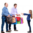 Two men giving shopping bags to a girl — Stock Photo