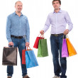 Two men with shopping bags — Stock Photo