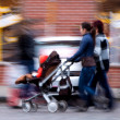 Two women walking with a stroller — Stock Photo