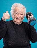 Happy old woman making fitness training with dumbbells — Stock Photo