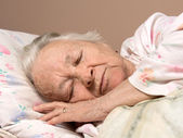 Sick senior woman — Stock Photo