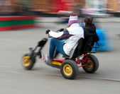 Couple riding a tricycle — Foto de Stock