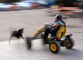 Boy racing in a pedal cart — Stock Photo