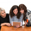 Three smiling women with tablet pc — Stock Photo