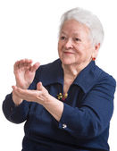 Old woman smiling and applauding — Stock Photo