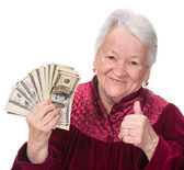 Smiling old woman holding money — Stock Photo