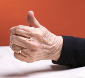 Woman's hand with thumb up. — Stock Photo