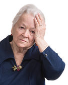 Old woman suffering from headache — Stock Photo
