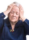 Anciana sufre de dolor de cabeza — Foto de Stock
