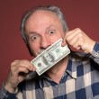Mholding with pleasure one hundred dollar bill — Stock Photo #40311787