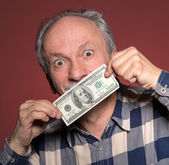 Man holding with pleasure one hundred dollar bill — Stock Photo