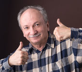 Happy elderly man showing ok sign — Stock Photo