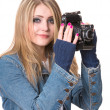 Ыmiling woman holding a vintage photo camera — Stock Photo