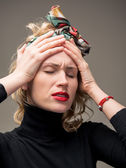 Woman suffering from headache — Stock Photo