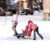 Family walking in the street in wintertime — Stock Photo