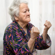 Old wommaking fists — Stock Photo #41082215