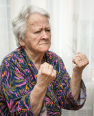 Old woman making fists — Stock Photo