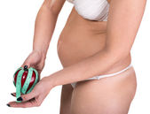 Woman holding apple and centimeter — Foto de Stock
