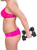 Overweight woman exercising with dumbbells  — Photo
