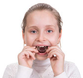 Girl putting on  medical braces for orthodontic treatment — Stock Photo
