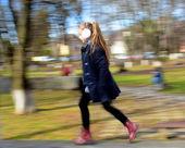 Happy little girl running — Стоковое фото